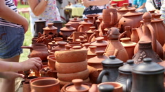Selling of pottery in the retail store outdoors Stock Footage