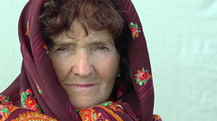 Side portrait of a Caucasian old woman dressing an headscarf Stock Footage