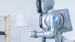 Modern robot giving cup of coffee to nice woman Stock Footage
