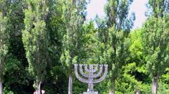 Menorah memorial in Babi Yar massacre place in Kiev, Ukraine. - stock footage
