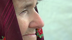 Lonely sad old woman side portrait: depressed old woman Stock Footage