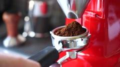 Coffee grinder grinding freshly roasted Stock Footage