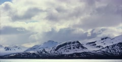 Timelapse of dramatic clouds over mountains in the arctic - stock footage