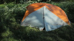 The man opens the tent, making a few photos on the phone and close the tent Stock Footage