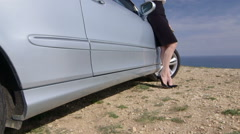 Business woman leaning on her car at the seaside using smartphone jib crane shot Stock Footage