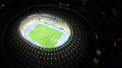 Bird's eye view on big soccer stadium with players, exciting football game Stock Footage