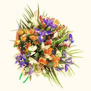 Bouquet of nerine, iris, alstroemeria, roses and other flowers. - stock photo