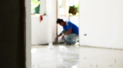 Worker putting ceramist tile on the floor.(out of focus) Stock Footage