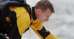 Man In Yellow Jacket Preparing To Go Sea Kayaking In The Ocean Stock Footage