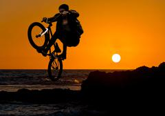 jump on a sunset background - stock photo