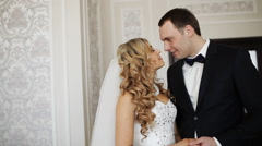 Bride and groom kissing in a stylish interior - stock footage