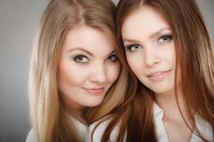 Charming positive female siblings. - stock photo