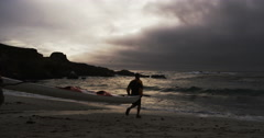 Adventurers Running Towards Storm And Crashing Waves With Sea Kayak Slow Motion Stock Footage