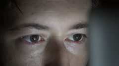 Computers Screen Reflected on Man's Eyes Looking Computer Closeup Stock Footage