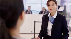 4K Friendly bank worker talking to customer & offering financial advice Stock Footage