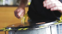 Playing a musical instrument repinique or drum Stock Footage