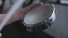 Playing a musical instrument tambourine Stock Footage