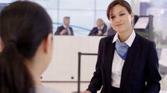 4K Friendly bank worker talking to customer & offering financial advice - stock footage