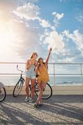 Best friends enjoying a day on seaside promenade - stock photo