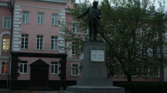 Full length statue of Vladimir Lenin is against building at evening. Russia Stock Footage