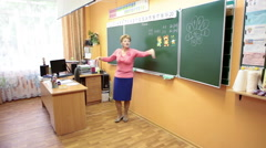 Russian school teacher a woman points at blackboard while teach a lesson. Russia Stock Footage
