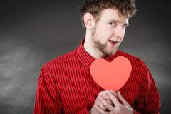 Boy in love with red heart. Stock Photos