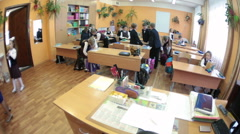 Start of the lesson at school, children come into the classroom. Russia Arkistovideo