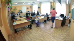 Free time before lesson start. Schoolkids talk each other in classroom. Russia Stock Footage