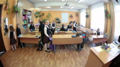 Beginning of educational day at the school, kids come into the classroom. Russia - stock footage