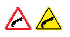 Warning sign of attention weapon. Dangers yellow sign gun. Magnum on red tria Stock Illustration