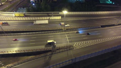 Vehicles driving at night highway, aerial view. St. Petersburg, Russia - stock footage