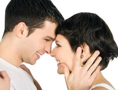 Profile of a smiling young couple in love - stock photo