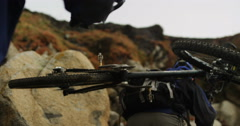 POV Two Men Carrying Mountain Bikes Up Hill In Slow Motion Steadicam Stock Footage