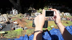 Tourist takes a picture with mobile the installation. Candelaria. Canary Stock Footage