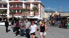 Tourists enter on the Plaza de la Patrona de Canarias. Candelaria Stock Footage