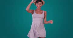 Happy smiling black woman dancing and having fun in flirty little dress - stock footage