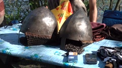 Helmets of medieval knights on the table Stock Footage