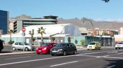 Vehicles drive on Constitucion avenue through the crossroad. Santa Cruz Tenerife Stock Footage