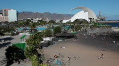 Small sandy beach is near the Auditorio de Tenerife building. Canary Stock Footage