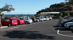Parking lot full of cars is in the Parque Maritimo Cesar Manrique, Santa Cruz Stock Footage