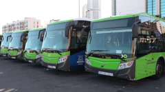 Passenger intercity green buses in line on bus station of Titsa company, Spain Stock Footage