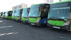 Passenger intercity buses stand in line on the bus terminal of Titsa company Stock Footage