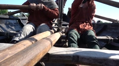 On the boat of medieval expedition crew rowing Stock Footage