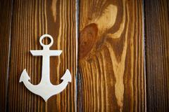 Wooden nautical anchor - stock photo