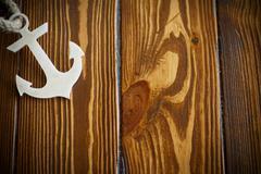 Wooden nautical anchor Stock Photos