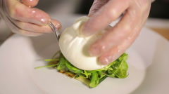 Burrata cheese served with fresh ruccola and grilled zucchini Stock Footage
