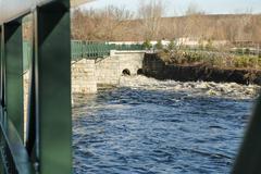 Water moving along Blackstone River Stock Photos