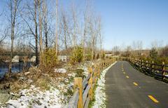 Bike path curving toward bridge - stock photo