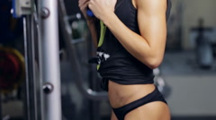 Sexy girl in gym. Putting plate on barbell Stock Footage