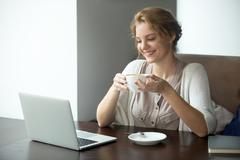 Half-length portrait of business woman on coffee break in cafe Stock Photos
